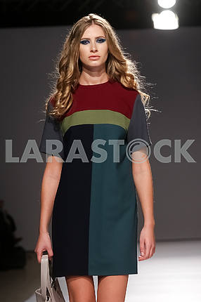 Model in a multi-colored dress from Gres