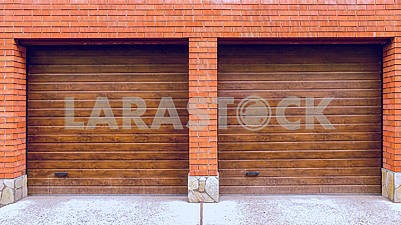 New brick garage with roller shutters for two car
