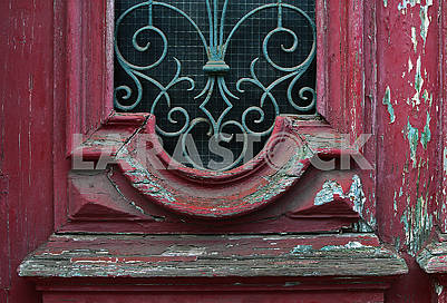Cracked red paint on old vintage door
