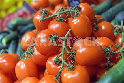 Tomatoes on display in a supermarket