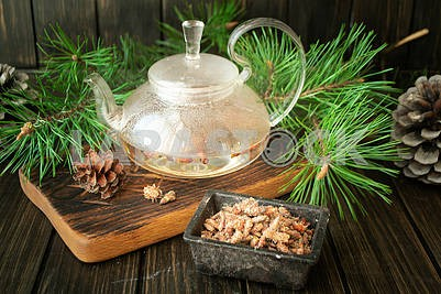 Medicinal decoction with pine buds in glass teapot