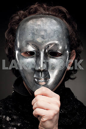 Man holding his hand in front of face mask