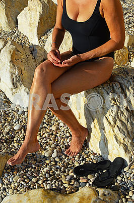 Young woman in a closed black swimsuit