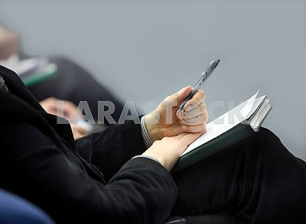 Hands of businessman with notebook