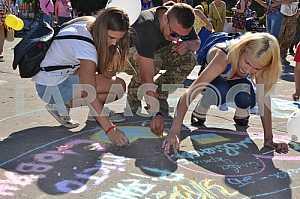 Children draw on asphalt
