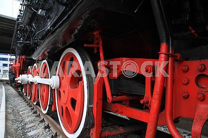 Wheels of a steam locomotive rolling