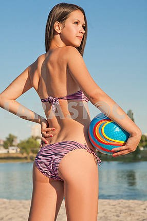 Young beautiful lady is holding volleyball ball