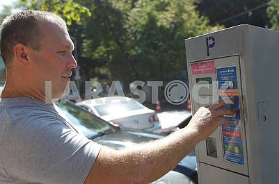 A man pays for parking