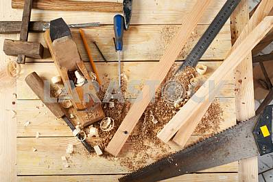 Carpenter tools on wooden table with sawdust. Circular Saw.