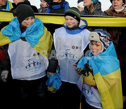 Children with Ukrainian symbols