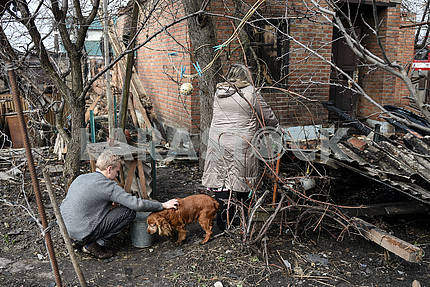Residents with a dog at a fire in Balakley