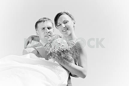 Portrait smiling groom and bride