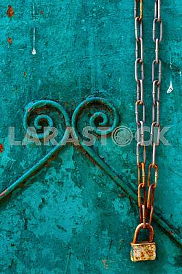 Background with a rusty chain with a lock