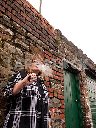 Mature Woman Smoking an Electronic Cigarette