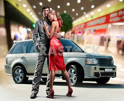 Portrait Young love Couple smiling under Offroad luxury car, int