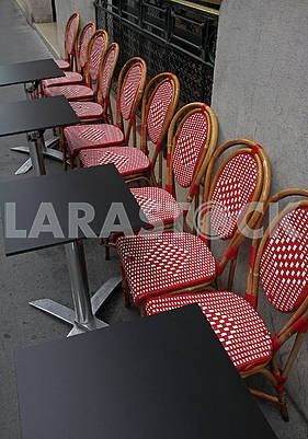 Black square tables and chairs