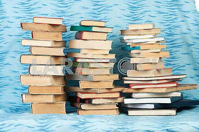 Old and used hardback books or text books on wooden table. Books and reading are essential for self improvement, gaining knowledge and success in our careers, business and personal lives. Copy space