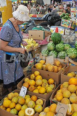 """Woman sells melons and watermelons in the market """"Privoz"""" July 5, 2012"""