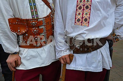 Two men in wide leather belts
