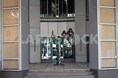 Singapore. Sculpture at the entrance to the building