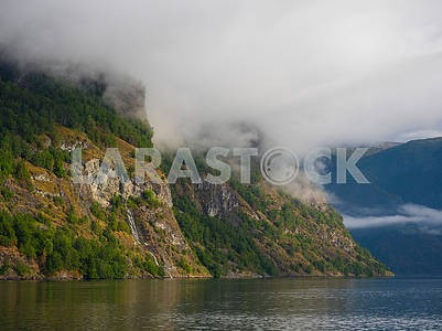 Mountain and clouds in Hardangerfjord