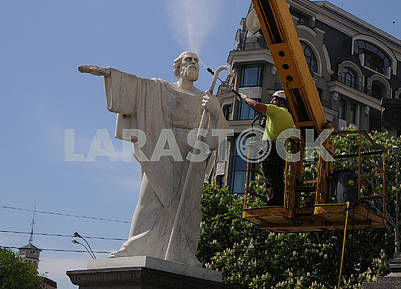 A cleaning company employee washes a monument to Andrew the First-Called