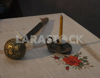Hetman mace and candle on the table