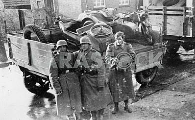 German soldiers near broken BMW motor cycle.