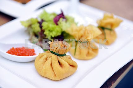 Pancake pouches with red caviar