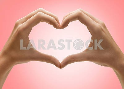 female hands form heart shape