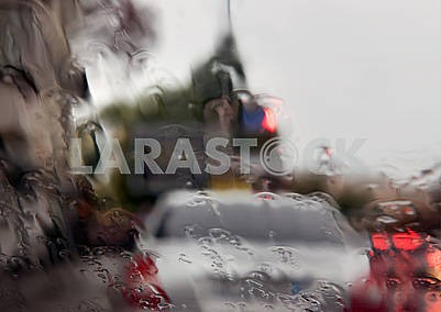 Rain on the forward pane of car