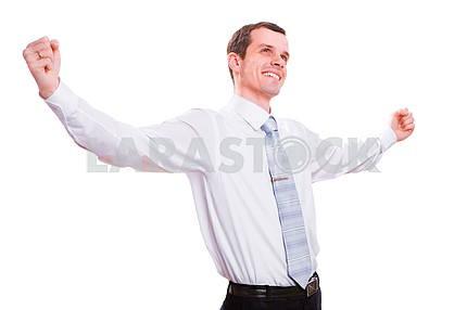 Happy businessman celebrating success. Isolated on white backgro