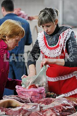 A woman sells meat on the market April 6, 2012