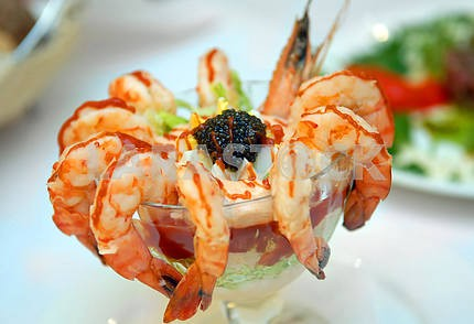 The cleared shrimps with black caviar
