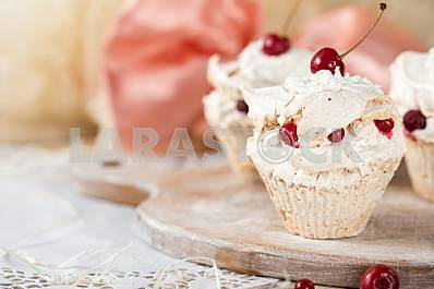 Air and light dessert of meringue with cream and berries .