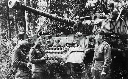 Soviet soldiers near the captured tanks