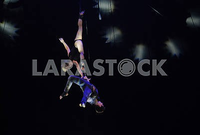 Acrobats under the circus dome