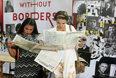 Girls read the newspaper publishers in the Forum