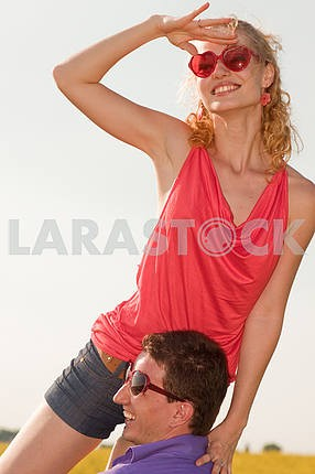 Young love Couple smiling under sky