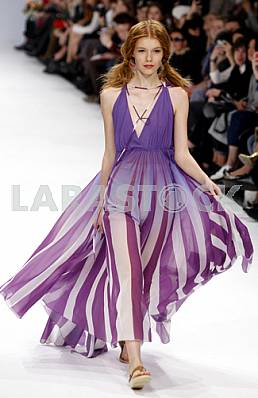Model in striped dress in violet shows outfit by Ukrainian designer Larisa Lobanova