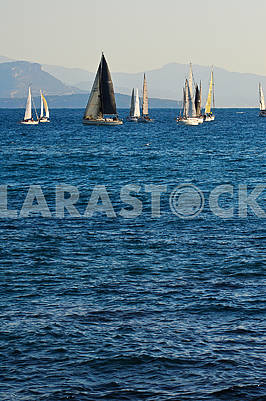 A group of sailing boats floating on the sea against the background
