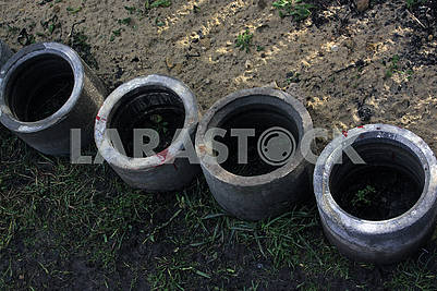 Four concrete drainage pipes