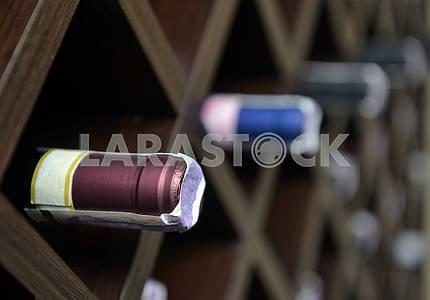 Red wine in bottles in wine shop