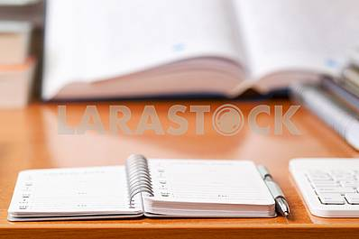Stack of hardback books on wooden table. Back to school. Copy space. Top view