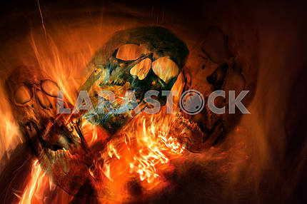 Fire in a fireplace  and three skulls