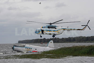 Helicopter and airplane on the water