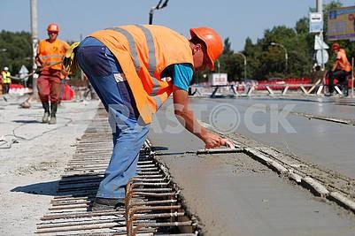 Workers repair overpass