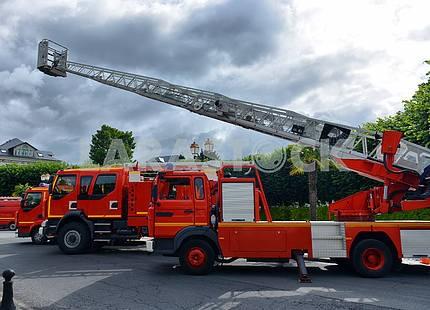 three fire trucks parked