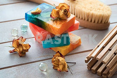 Organic handmade soap. Colorful soap with dry rose flowers