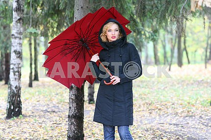 Beautiful blonde outdoors in coat and hat